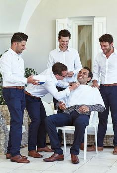 Greek groom being shaved by groomsman