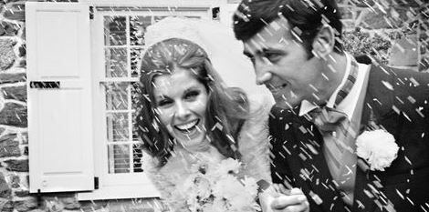 bride and groom in the rain on their wedding day