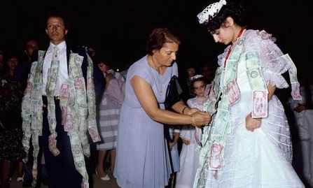 bride and groom pinned with money