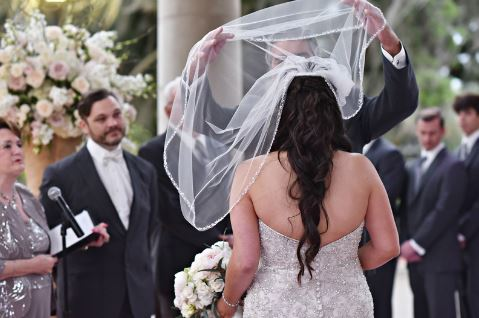 Father lifting Bride wedding veil