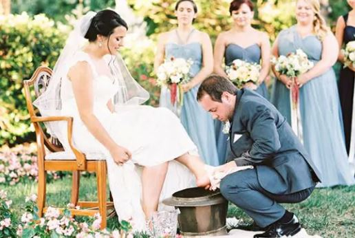 Groom washing Bride's Feet