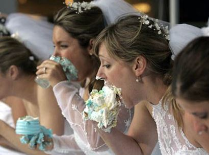 Bride eating wedding cake