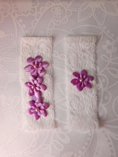 Pair of Lilac Purple Garters with Flower emblems on White Lace