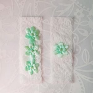 Garter Pair | Light Green Flower Emblems on White Lace