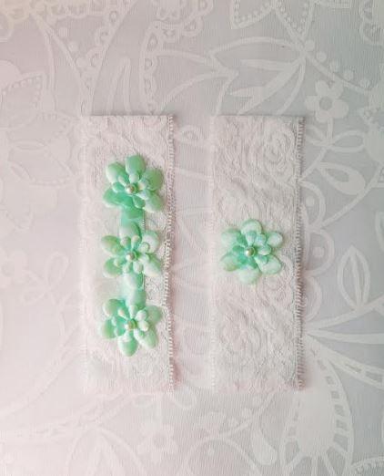 Garter Pair | Light Green Flower Emblems on White Lace