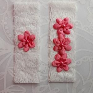 Pair of Pink Garters with Flower emblems on White Lace